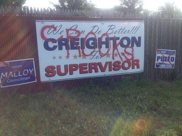Four campaign signs of Smithtown Councilman Robert Creighton,