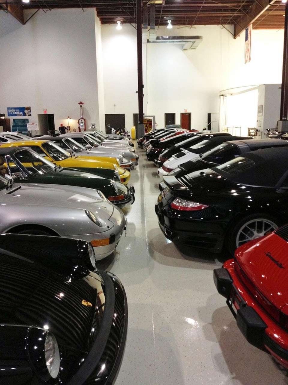 A row of classic Porsches sit on display