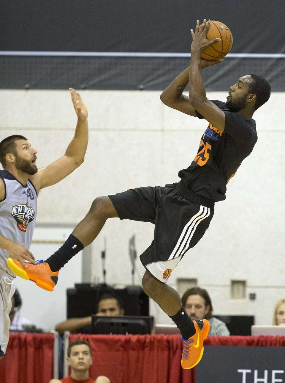 Knicks forward C.J. Leslie, left, shoots against New