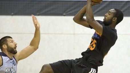 Knicks forward C.J. Leslie, left, shoots against New