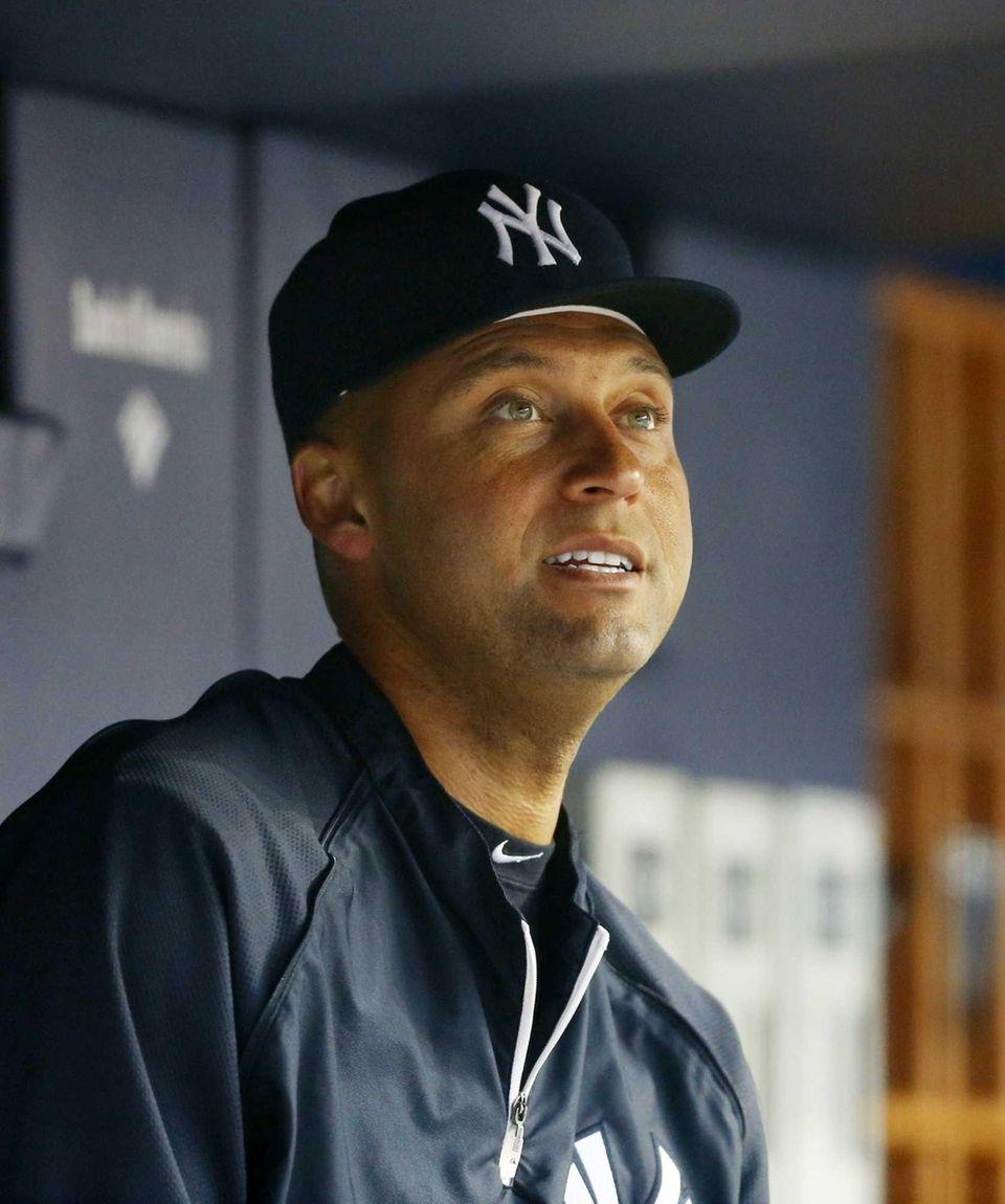 Yankees shortstop Derek Jeter looks on from the