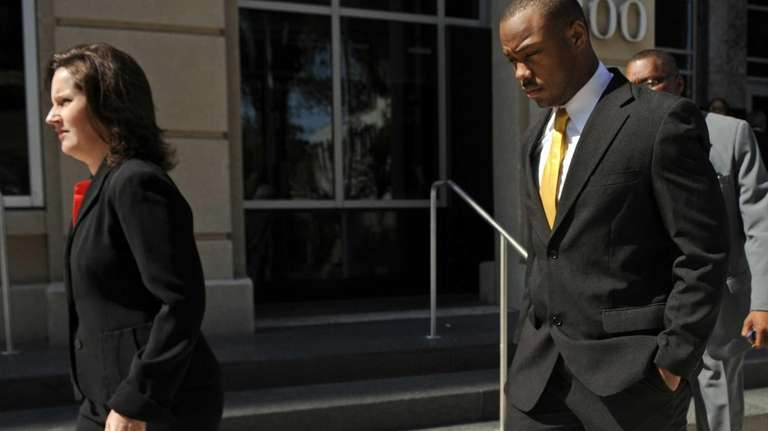 Suspended LSU running back Jeremy Hill, right, has