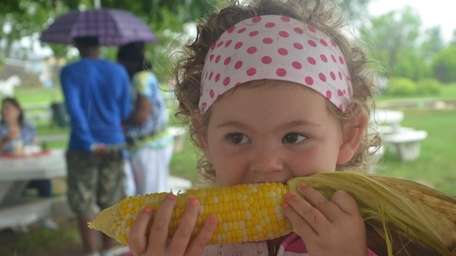 Emma Roner, 2, of Greenport, couldn't help but