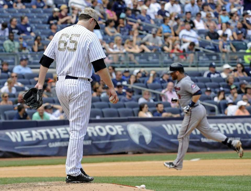 Yankees pitcher Phil Hughes reacts as Minnesota Twins'