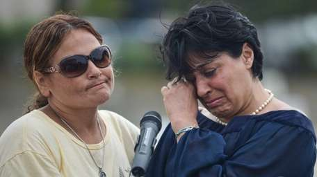 Sidonie Fery's mother Mimi Fery, right, is comforted