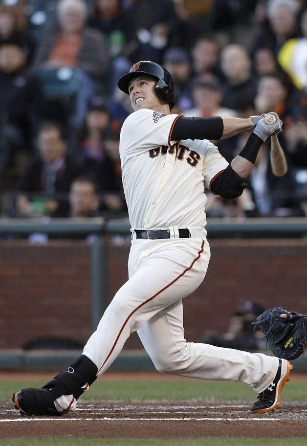San Francisco Giants' Buster Posey hits a two-run