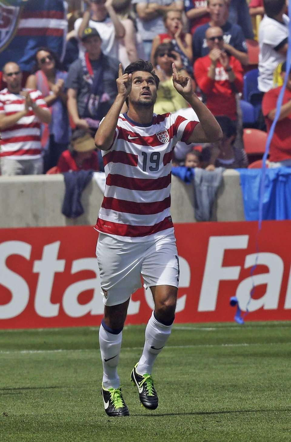 Chris Wondolowski celebrates after scoring against Cuba during