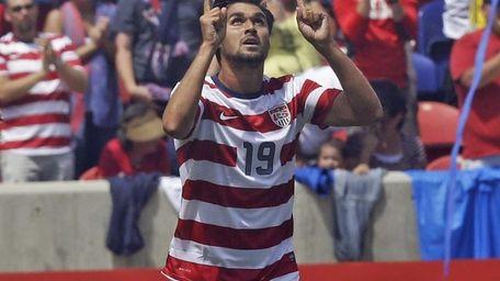 Chris Wondolowski celebrates after scoring against Cuba during