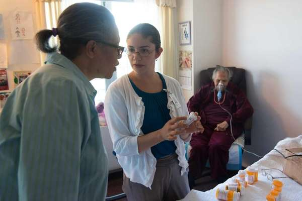Dr. Alejandra Villalobos, center, performs a check-up on