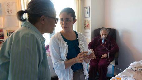 Dr. Alejandra Villalobos, center, performs a check-up on