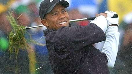 Tiger Woods plays from the rough, in the