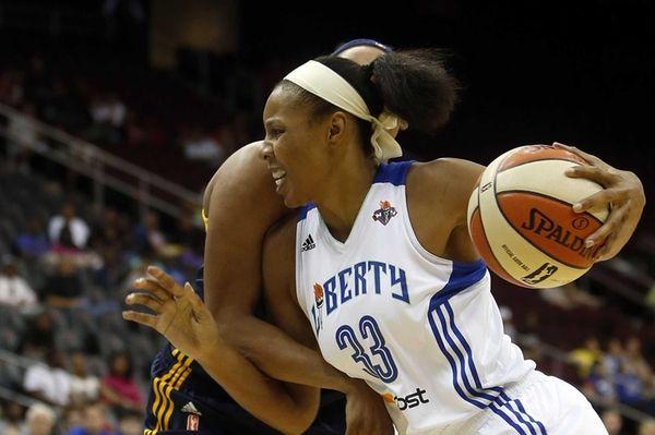 Liberty's Plenette Pierson drives to the basket against