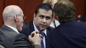 George Zimmerman, center, talks to his attorneys Don