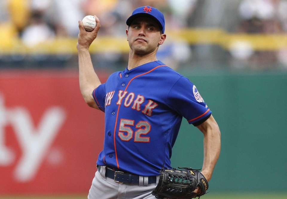 Carlos Torres of the Mets pitches in the