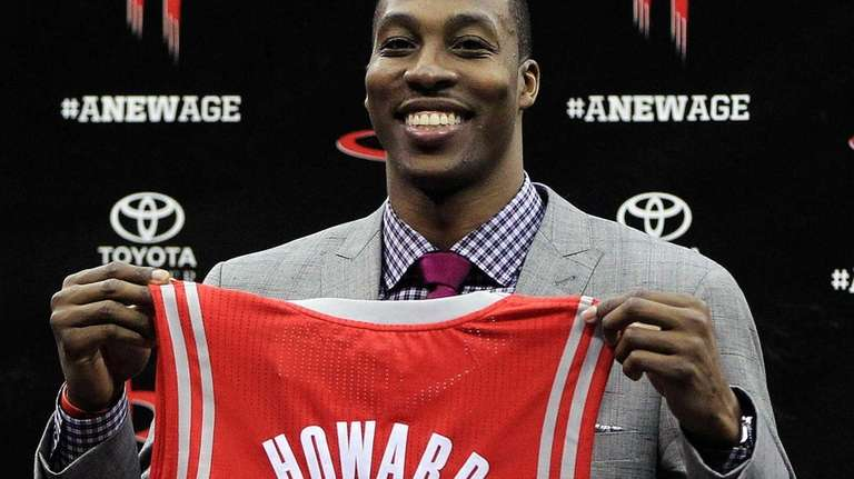 Dwight Howard holds his Houston Rockets jersey during