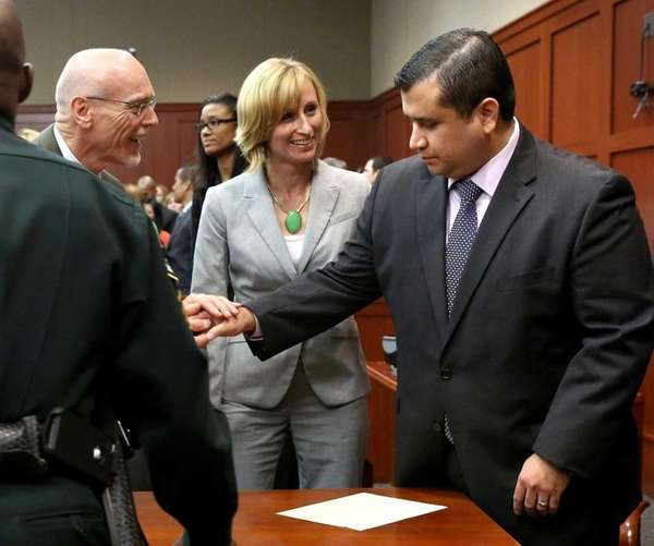 George Zimmerman is congratulated by his defense team,