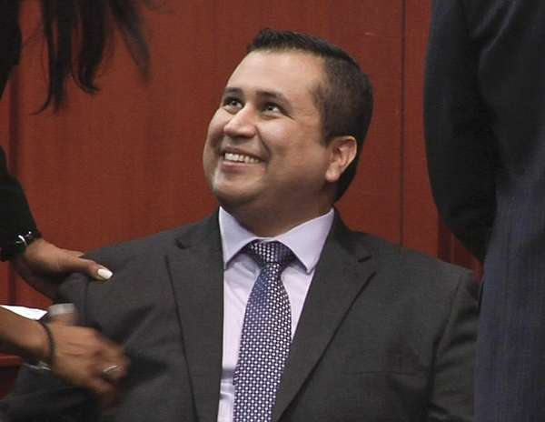 In this image from video, George Zimmerman smiles