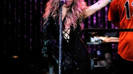 Mariah Carey performs during 2013 Major League Baseball