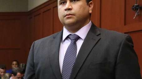 George Zimmerman listens as the verdict is announced