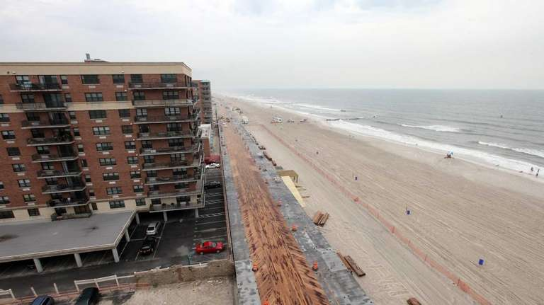 Construction of the boardwalk is pictured from the