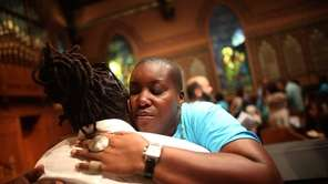 People hug during services at Middle Collegiate Church