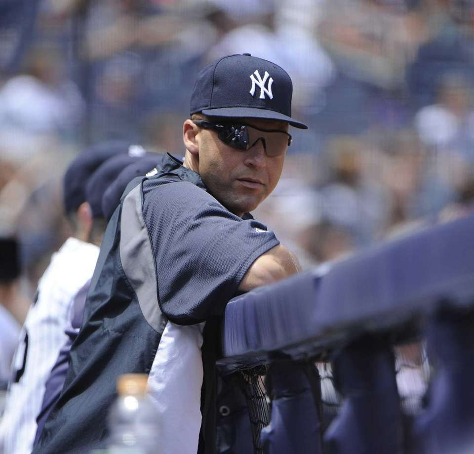Derek Jeter looks on from the dugout in