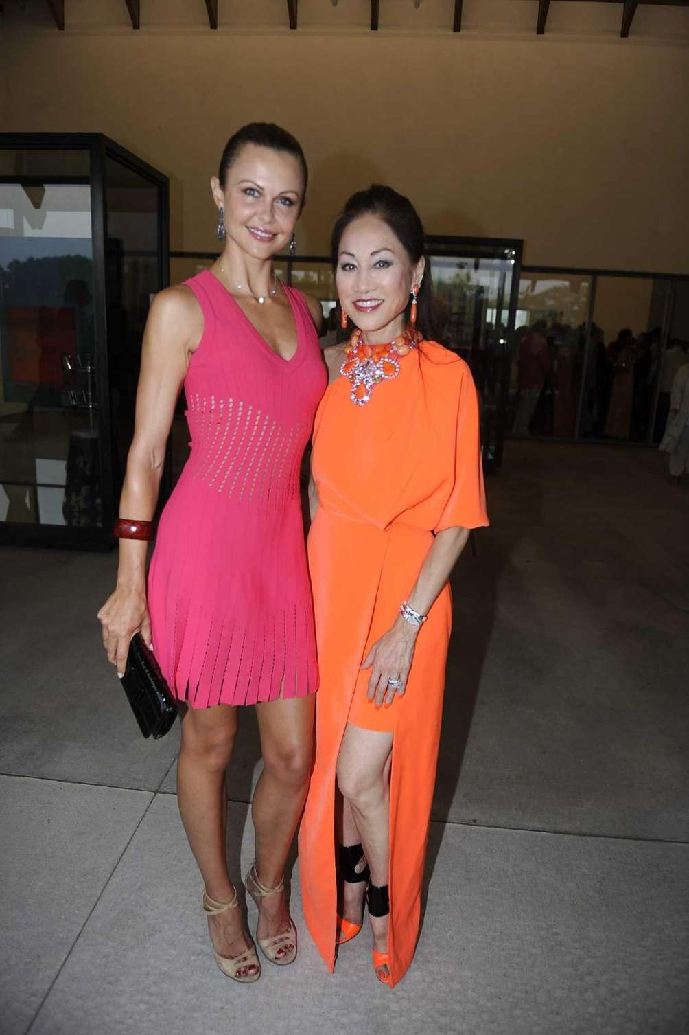 Lauren and Lucia Hwong Gordon in neon dresses
