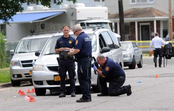 Nassau County police investigate the scene of a