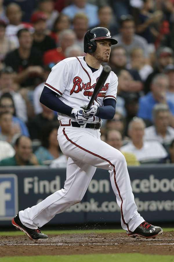 Atlanta Braves first baseman Freddie Freeman drives in
