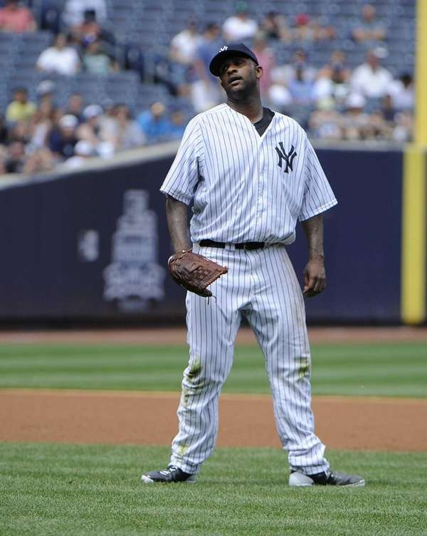 CC Sabathia reacts in the fourth inning of
