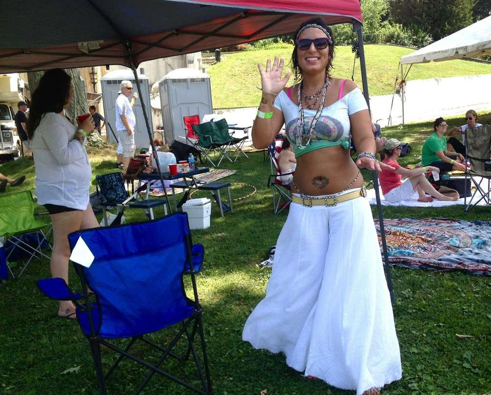 Luana Halili, 33, of North Bellmore, dances to
