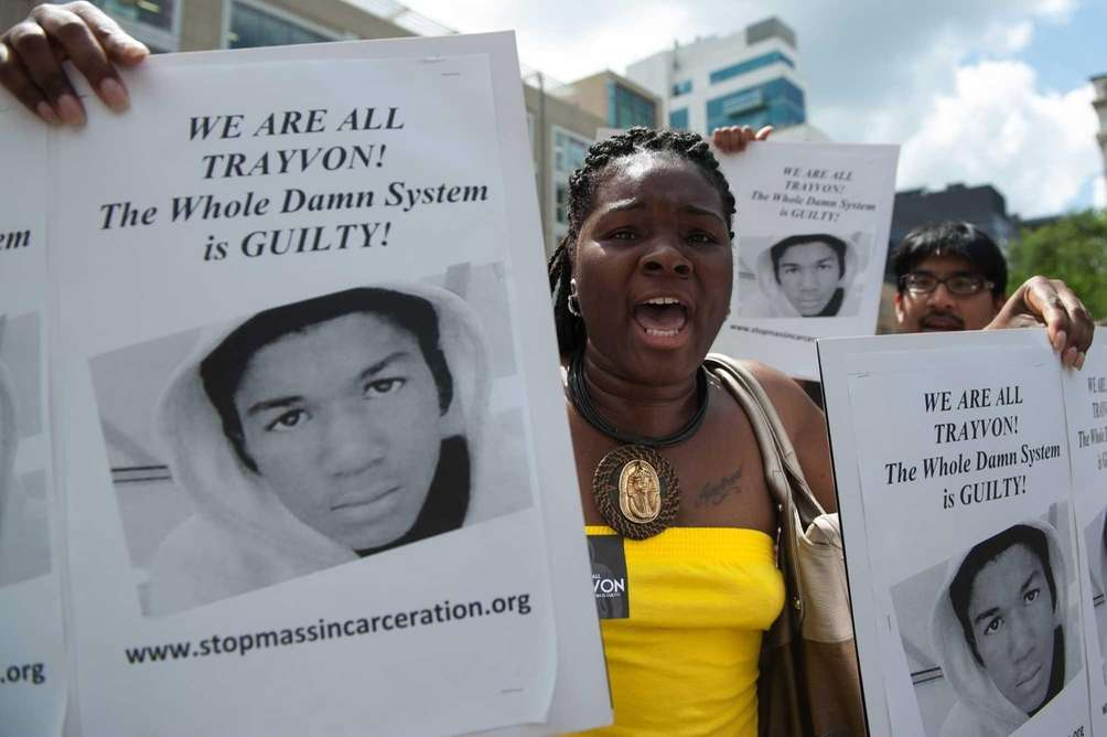 Demonstrators attend a protest of the George Zimmerman
