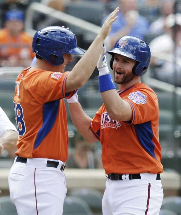 The United States' Matt Davidson, right, celebrates with