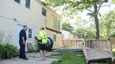 A deck collapsed in the backyard of a