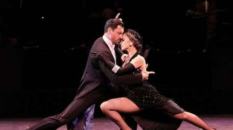 Maksim Chmerkovskiy and Karina Smirnoff perform at the