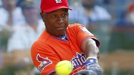 Ozzie Smith bats during the All-Star Legends and