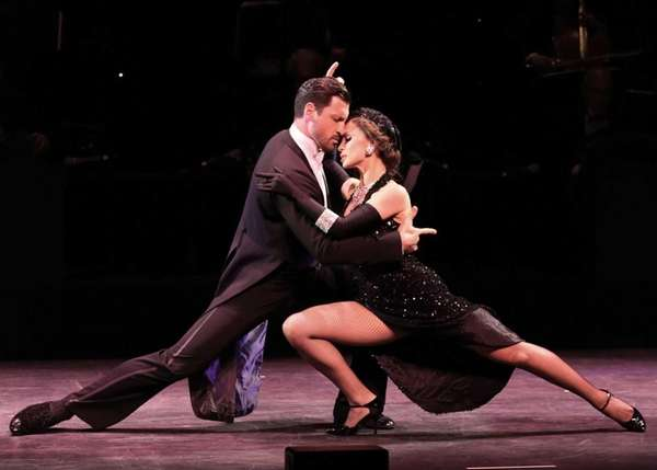 Dancers/TV personalities Maksim Chmerkovskiy and Karina Smirnoff perform at the 'Forever Tango' Press Preview at Walter Kerr Theatre in New York. (July 11, 2013)