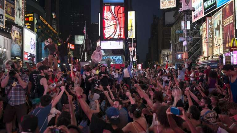 Demonstrators attend a protest march in Times Square