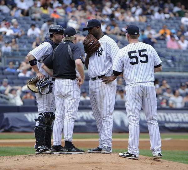 Larry Rothschild speaks to CC Sabathia in the