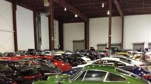 Rows of vintage automobiles sit on display at