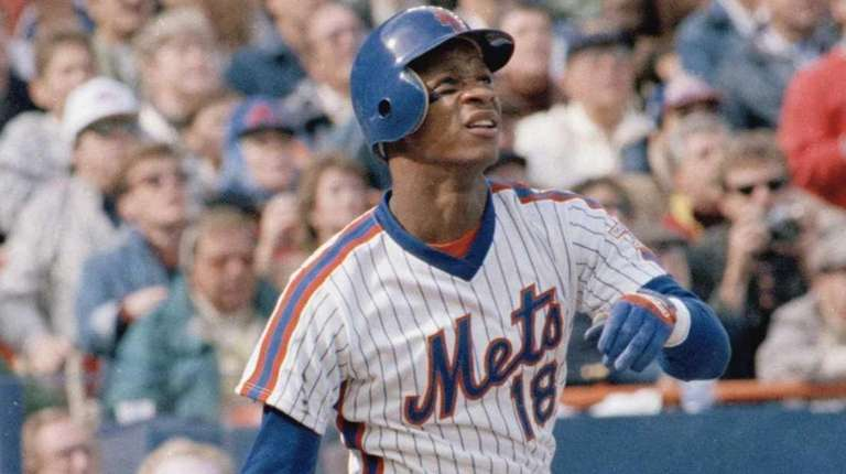 Mets outfielder Darryl Strawberry looks on after a