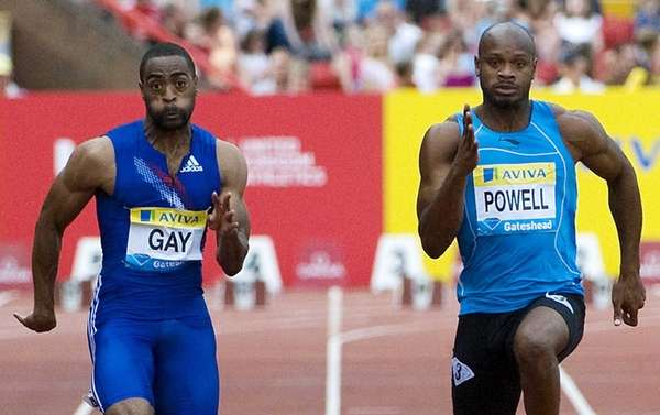 Tyson Gay (L) running against Jamaica's Asafa Powell