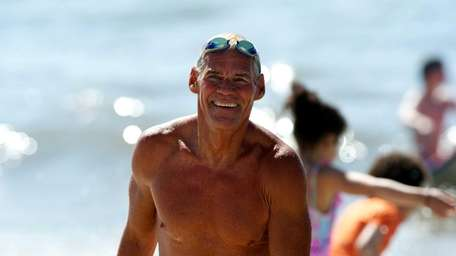 Jones Beach lifeguard, Ed Peters, 70. He supervises