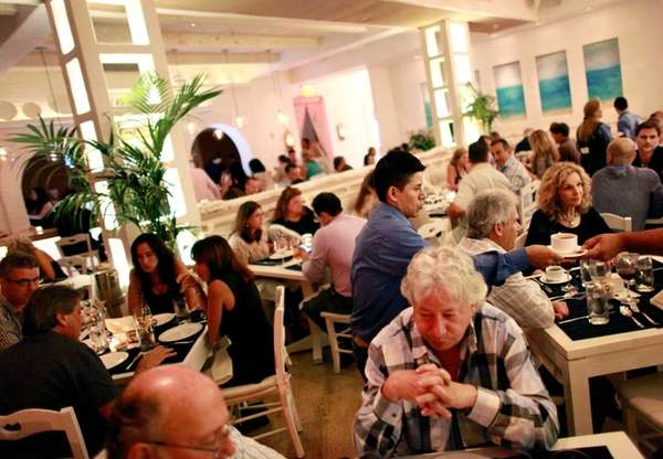 Patrons dine at Kyma in Roslyn. (July 12,
