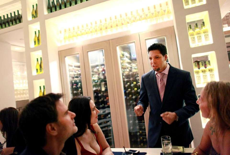 Managing partner Reno Christou chats with diners at