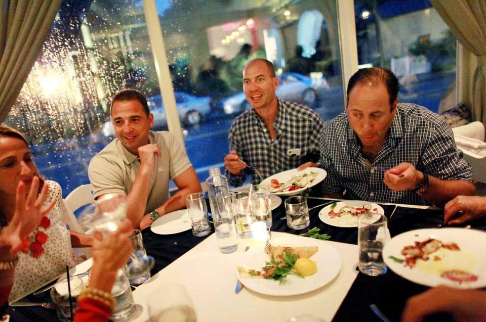 Patrons dine on the offerings at Kyma restaurant
