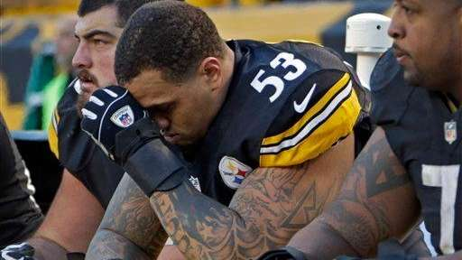 Pittsburgh Steelers center Maurkice Pouncey, center, sits on