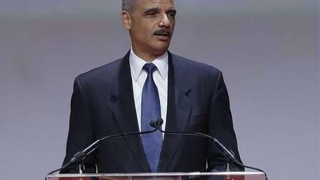 Attorney General Eric Holder speaks at the Delta