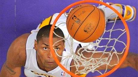 Then-Los Angeles Lakers forward Metta World Peace watches