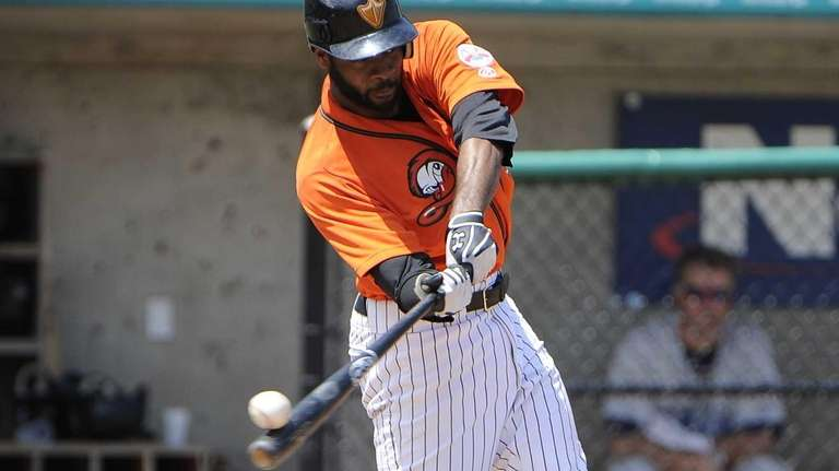 P.J. Phillips of the Long Island Ducks flies